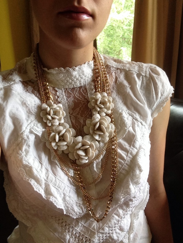 lace top with layered necklaces