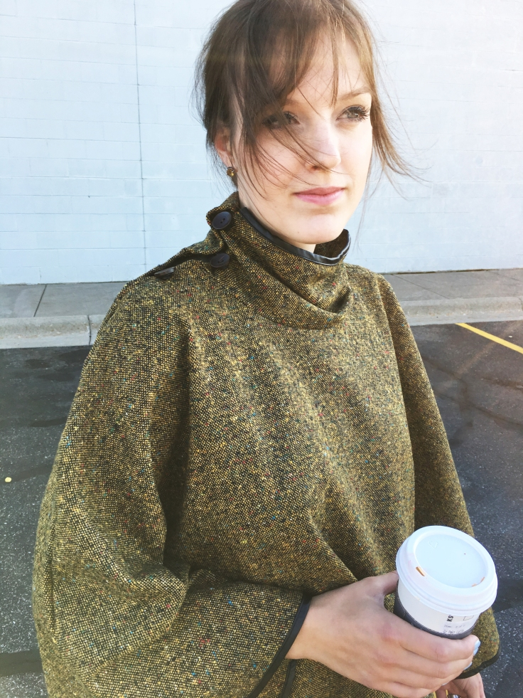 close-up-of-trunk-up-boutique-olive-cape-and-coffee-cup