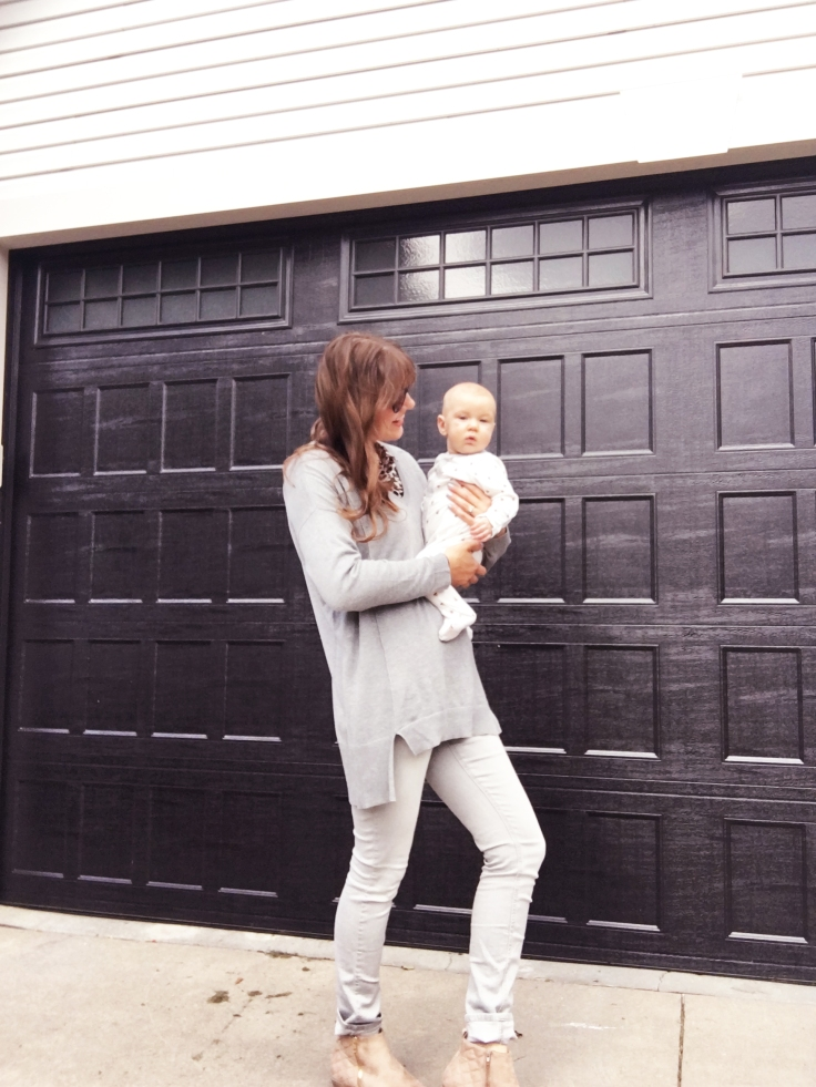 far-away-picture-of-me-holding-baby-boy-wolfie-justfab-sweater-maurices-pants-just-fab-booties-shoes-and-old-navy-candy-corn-onesie-for-baby-boy
