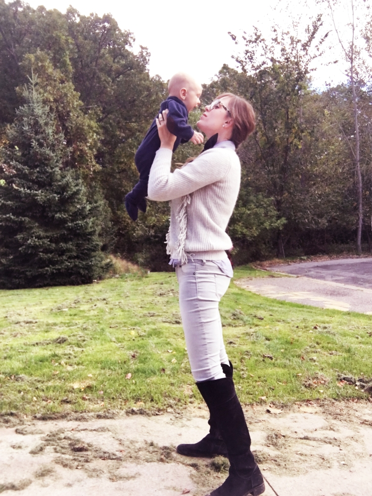 horse-riding-outfit-for-fall-transitional-outfit-for-fall-weather-equestrian-look-holding-baby-boy-in-air-playing-mother-son-mom-and-child