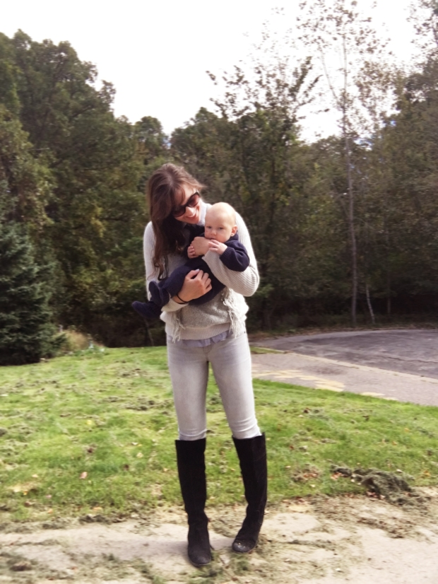 horse-riding-outfit-for-fall-transitional-outfit-for-fall-weather-equestrian-look-holding-baby-boy-wolfie-who-is-wearing-a-sweater-onesie-horseback-riding