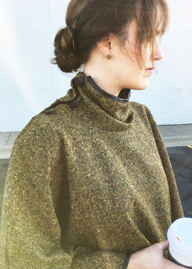 side-view-and-closeup-of-trunk-up-boutique-olive-cape-poncho-and-coffee-cup