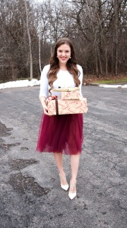 presents with white shirt and red tulle skirt with white heels, walking