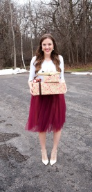 presents with white shirt and red tulle skirt with white heels