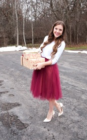presents with white shirt and red tulle skirt