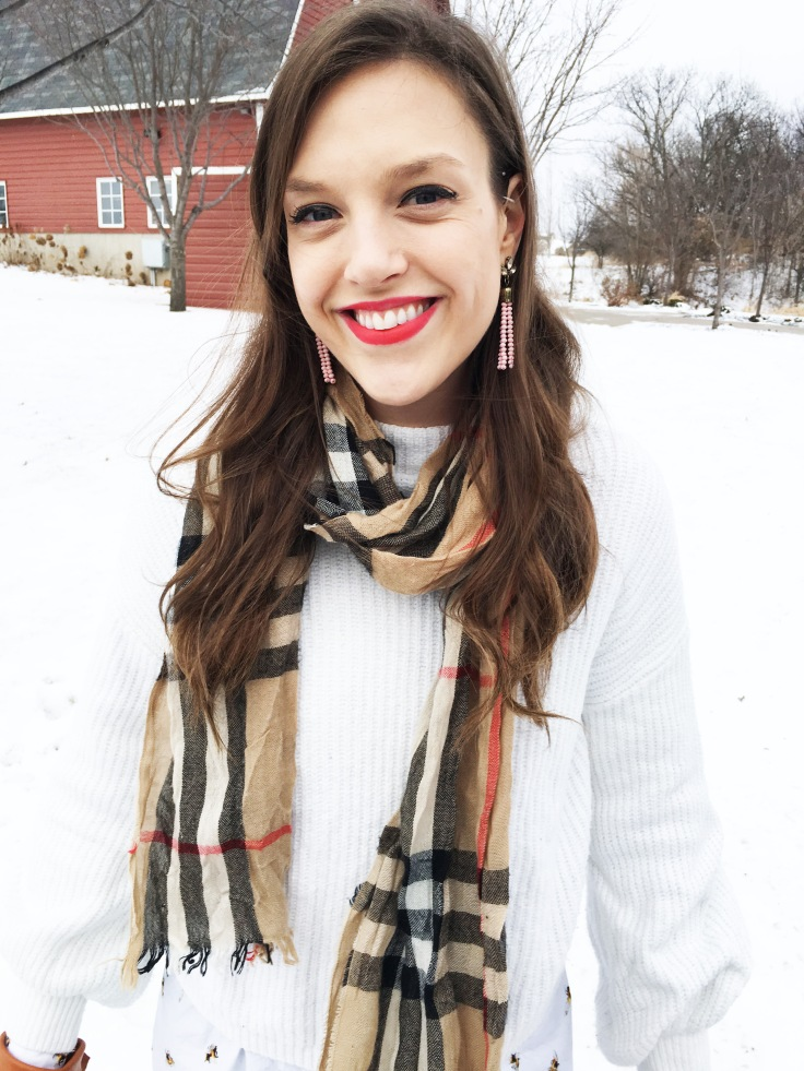 closeup with white sweater and burberry plaid scarf