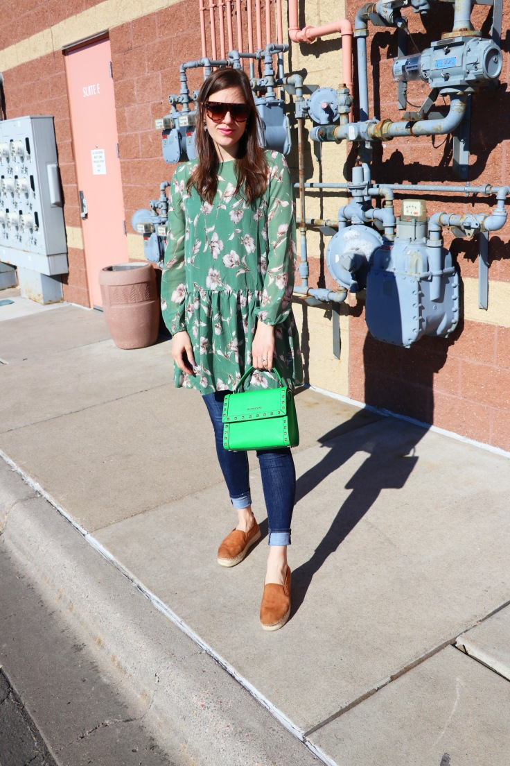 blogger standing pose with green bag and dress saturation 1