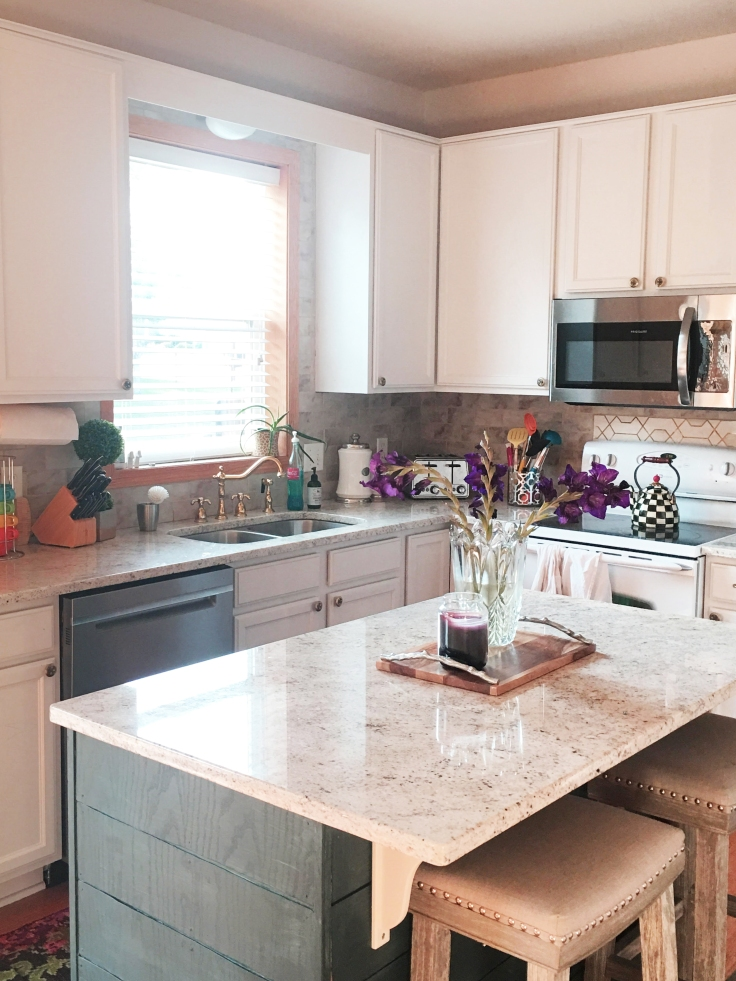 kitchen remodel after picture with blue shiplap island and white kitchen cabinets.jpg
